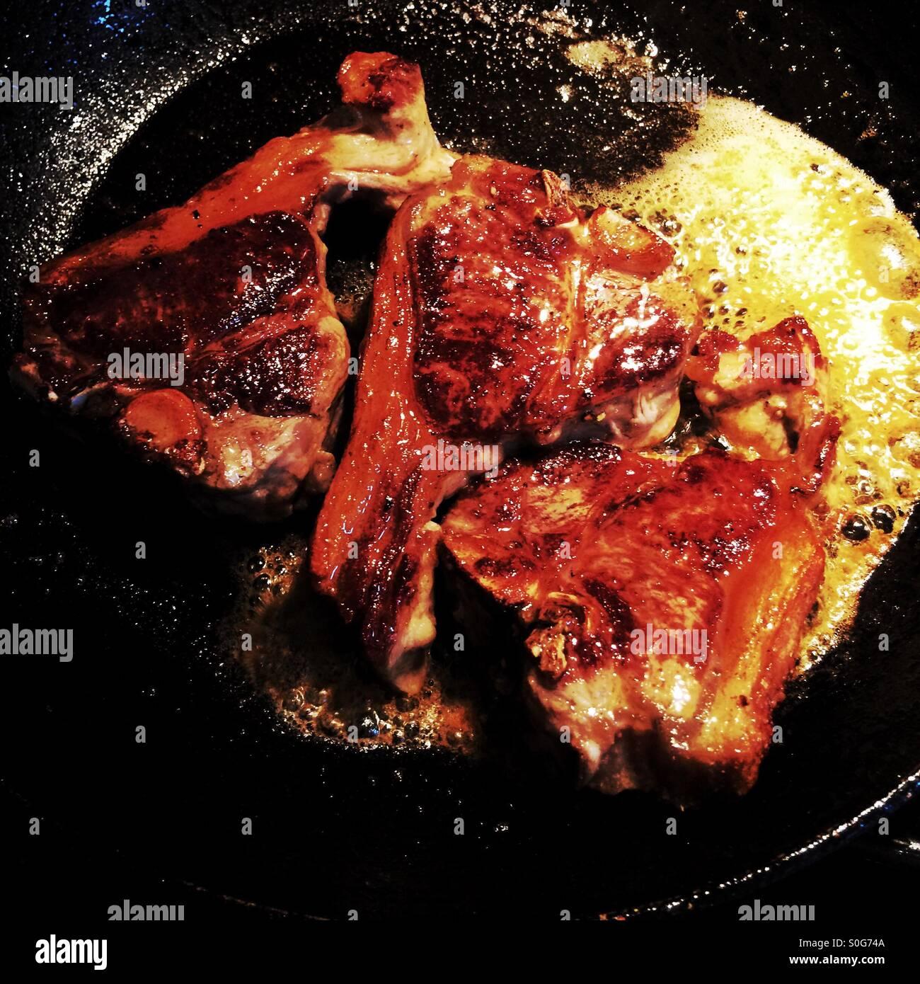 Lamb chops in a frying pan Stock Photo