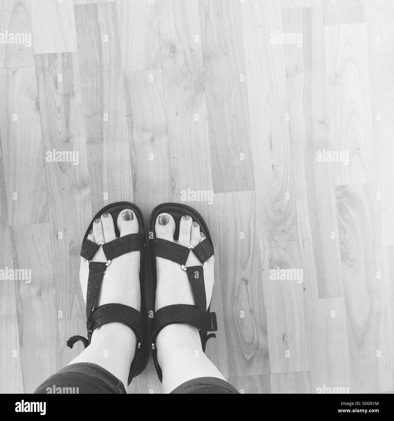Black and white feet - Stock Image