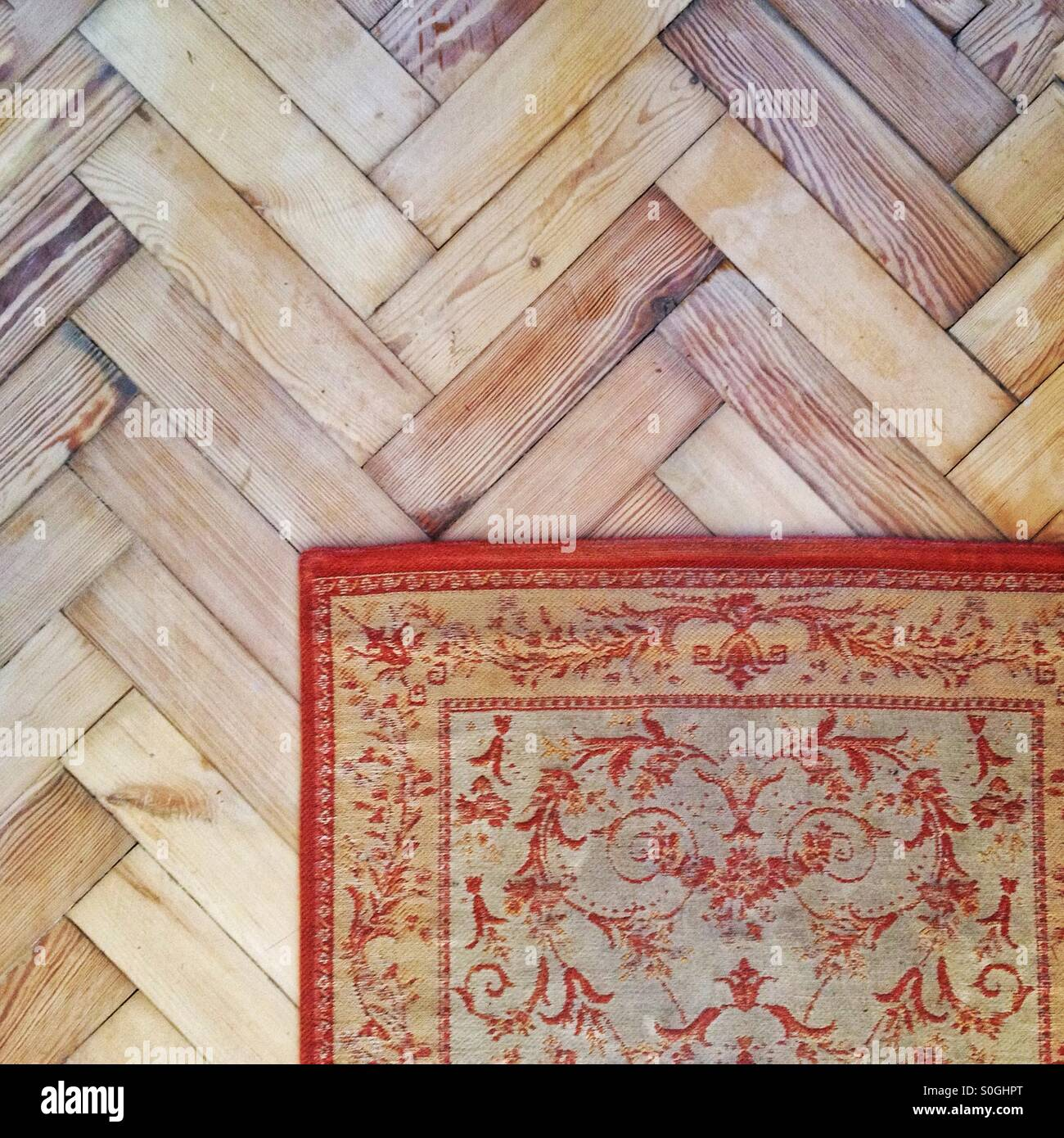Parquet floor and rug - Stock Image