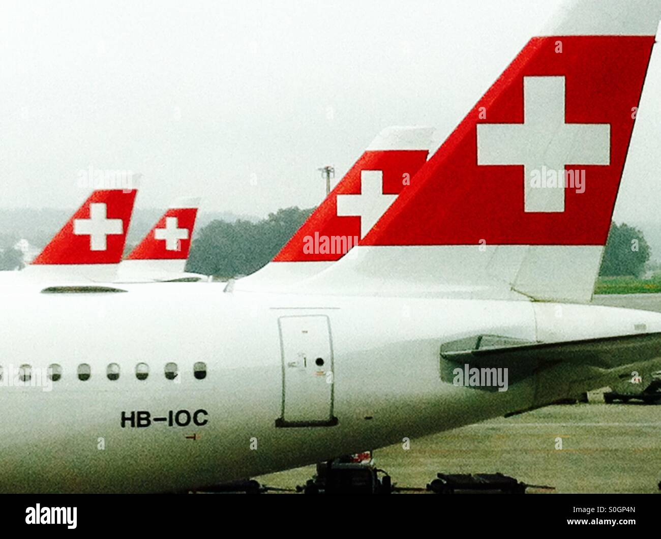 Four aeroplanes in the swiss airport - Stock Image