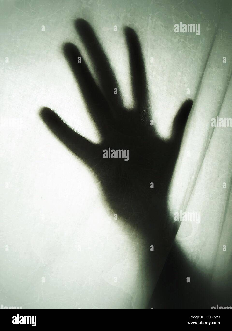 Spooky hand shadow - Stock Image
