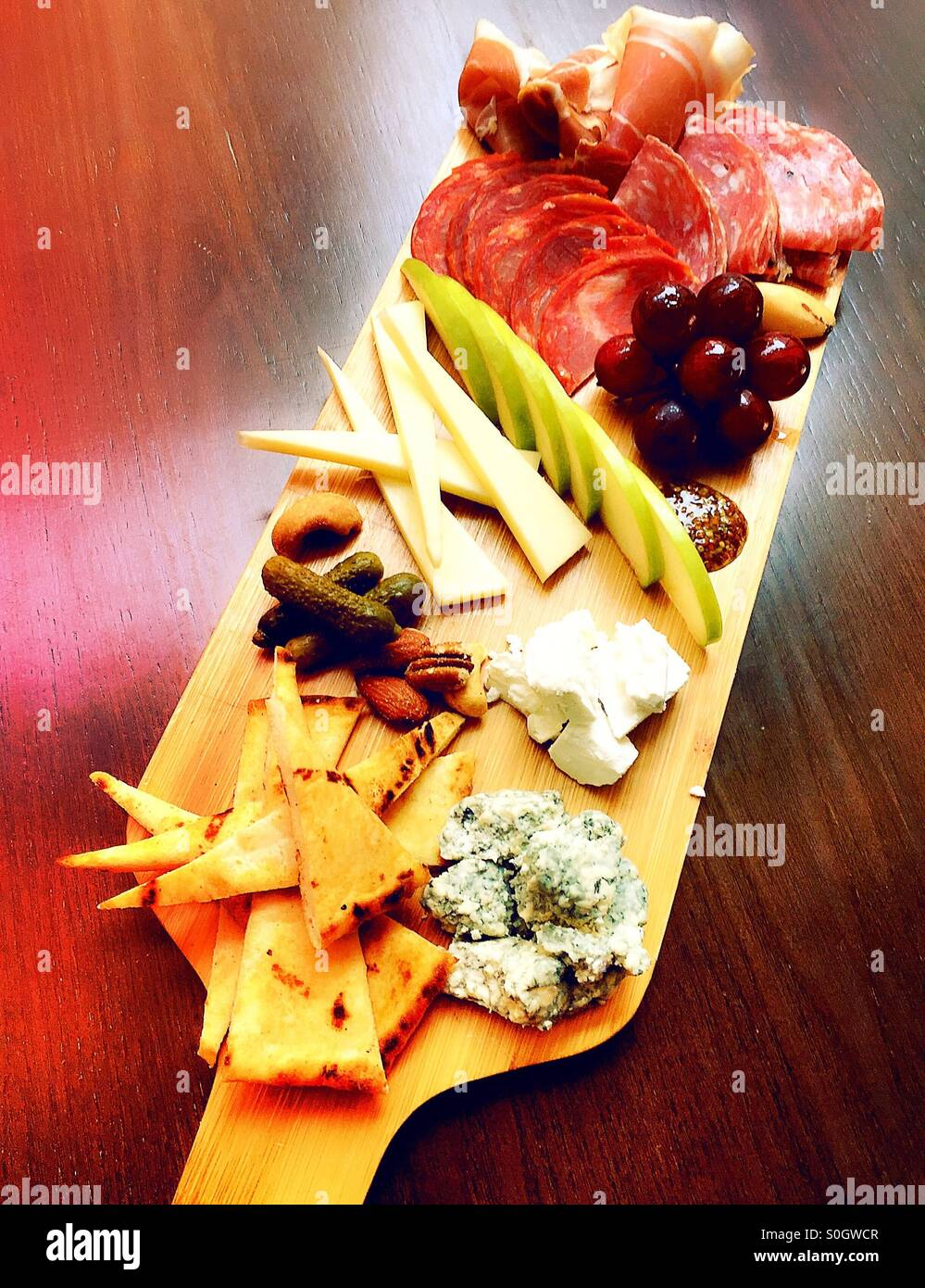 Charcuterie platter of meat and cheese and fruit - Stock Image