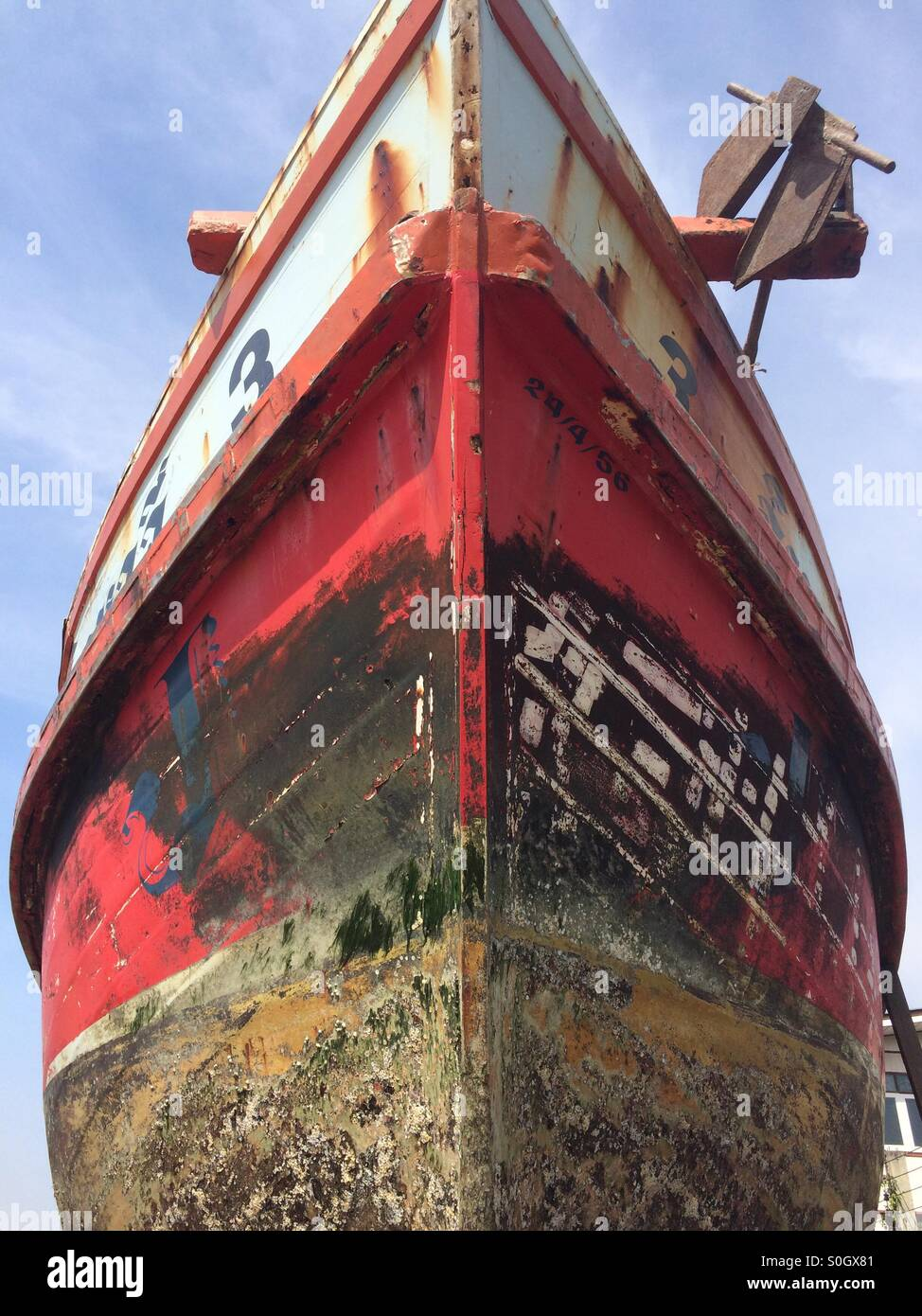 Low angled view of the bow of a fishing boat in a dry dock, Mahachai, Thailand. - Stock Image