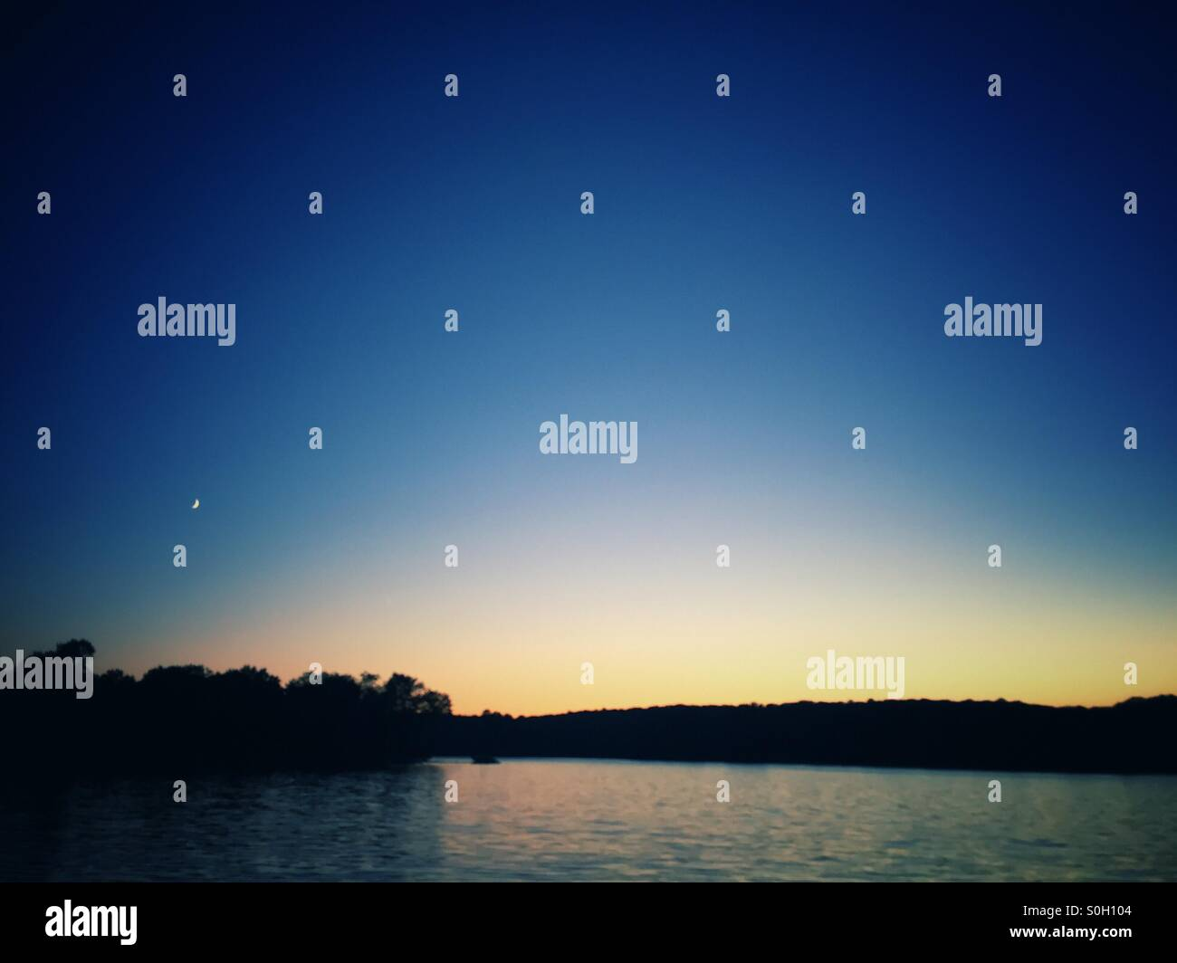 Sunset over lake in cottage country, haliburton, ontario - Stock Image