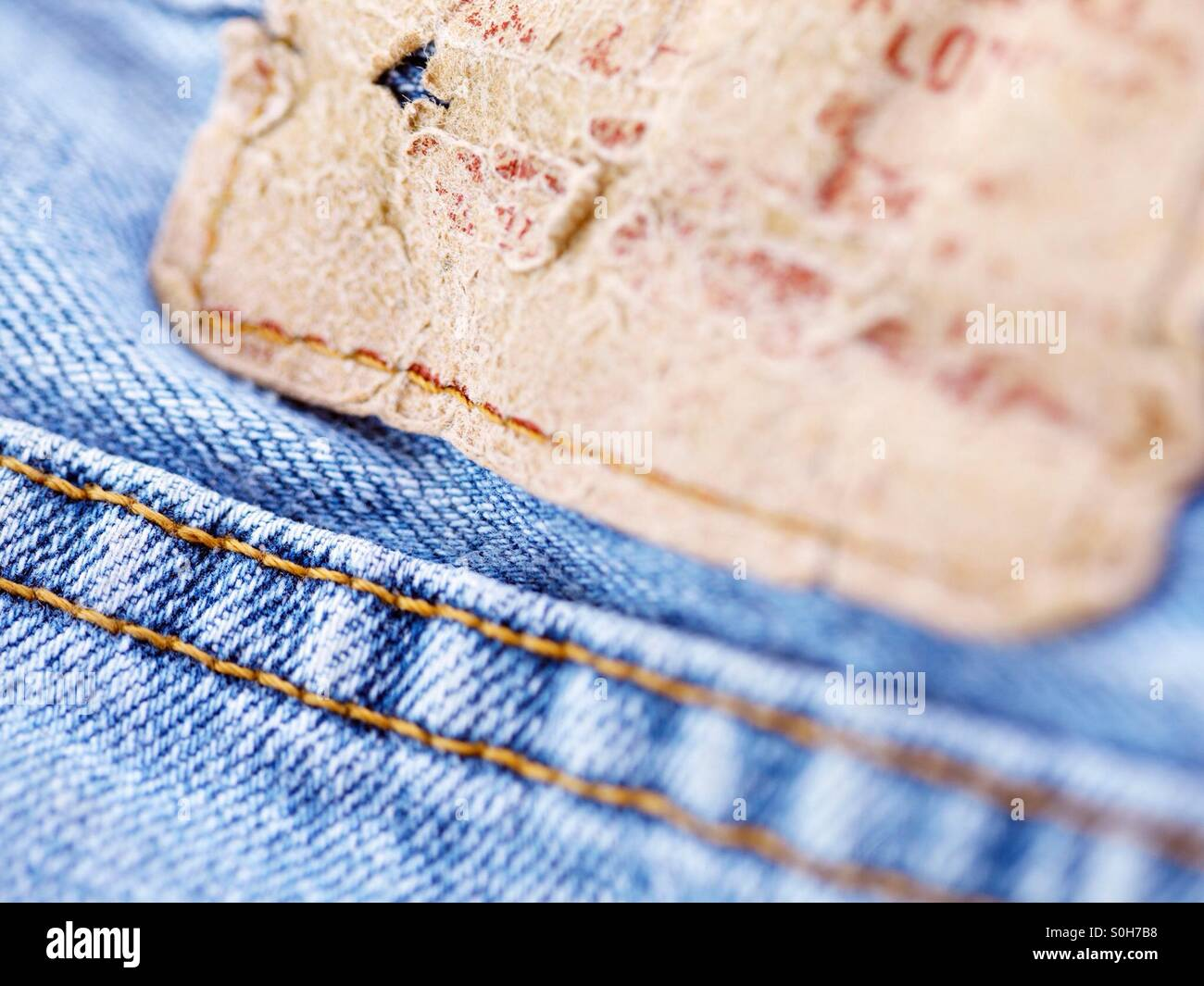 e8c3855f Closeup of the tag on an old pair of jeans. - Stock Image