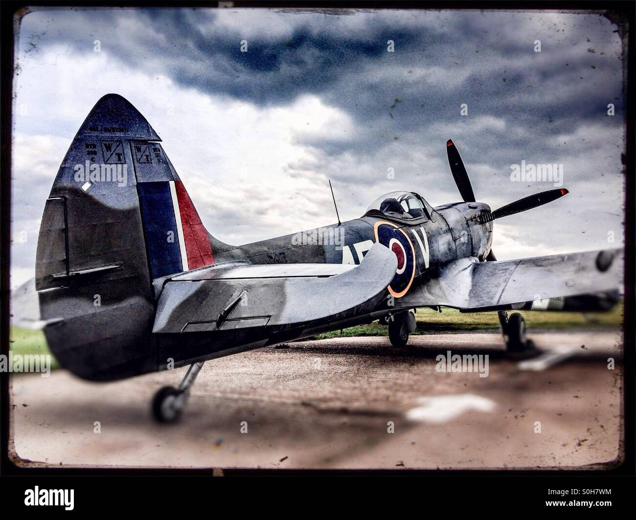Spitfire aeroplane at airfield just outside London - Stock Image