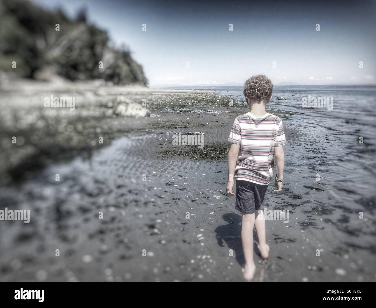 Walking the beach in Kingston, Washington, USA - Stock Image