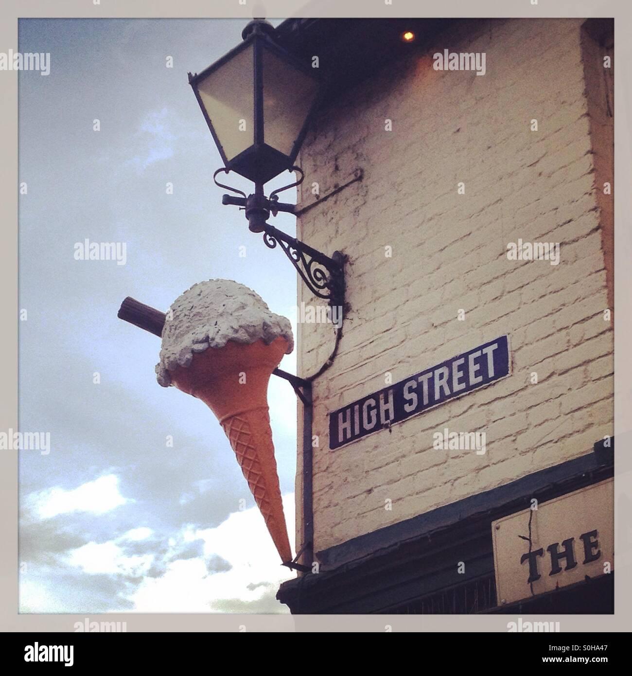 Plastic ice cream sign on shop wall - Stock Image
