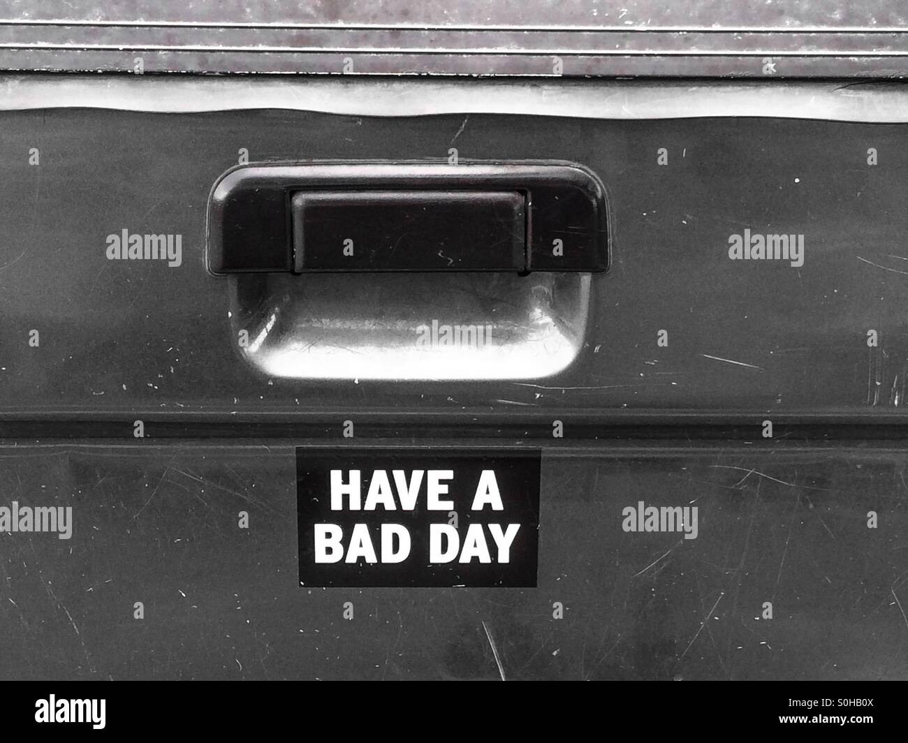 Bumper sticker on a car reads 'have a bad day' - Stock Image