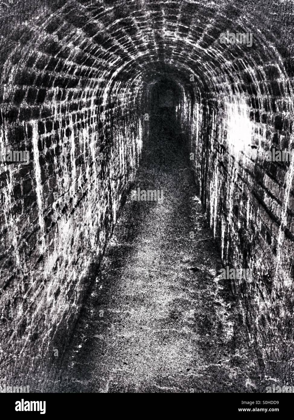 Red brick passage way - Stock Image
