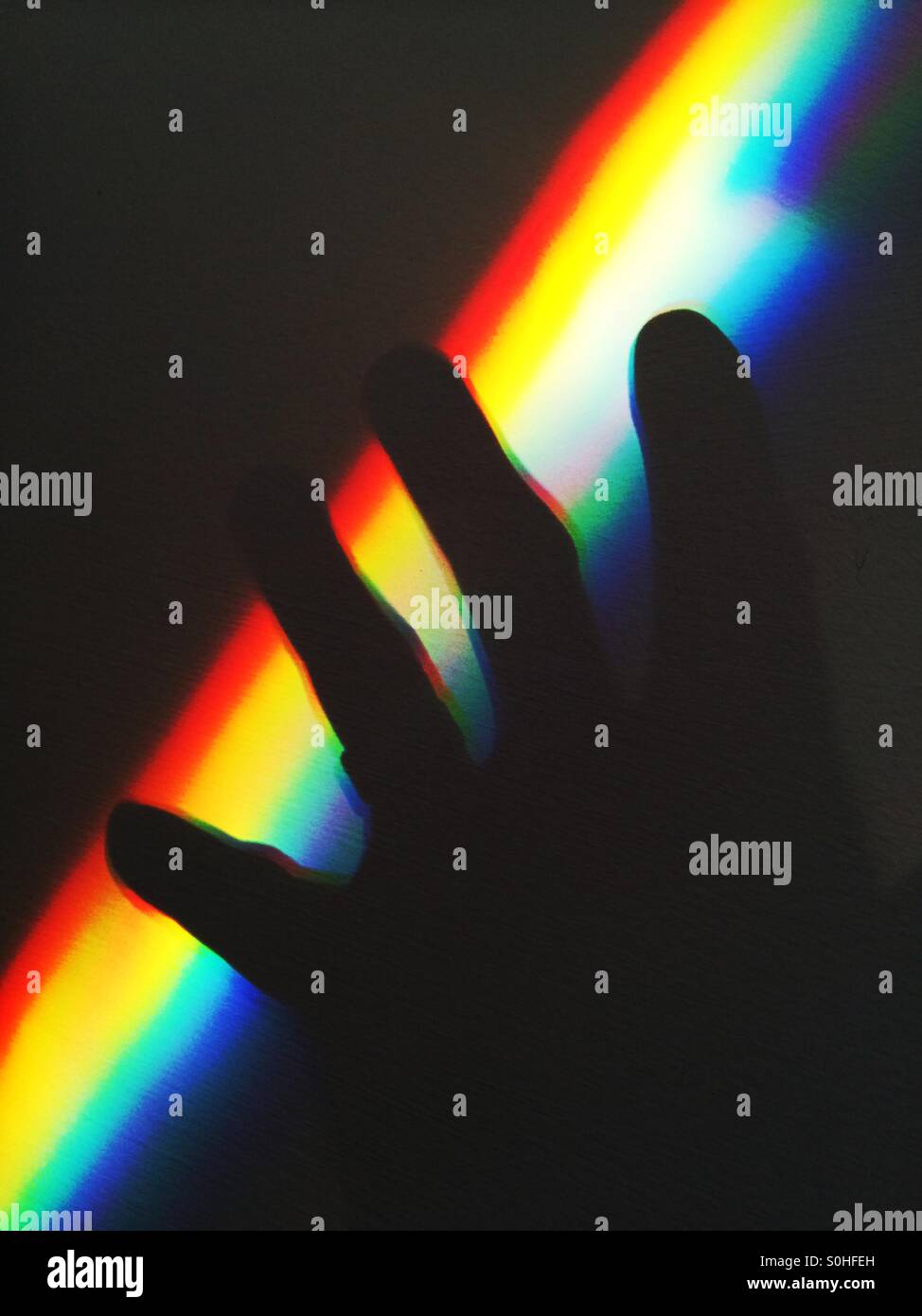 Spectrum and hand shadow - Stock Image