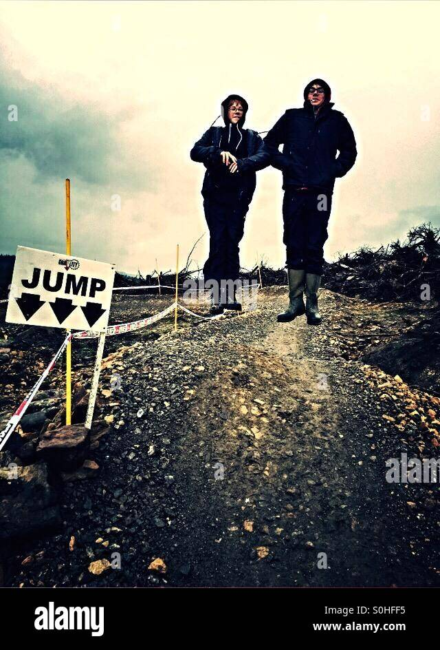 The sign says jump so we did ! - Stock Image
