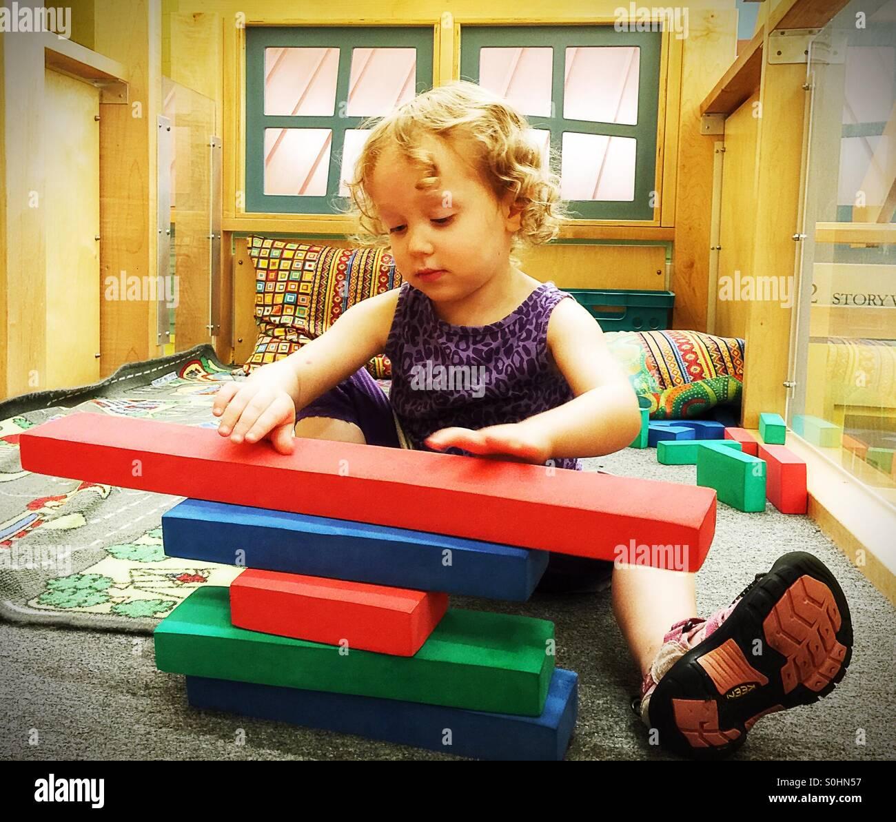 Preschooler building with blocks - Stock Image