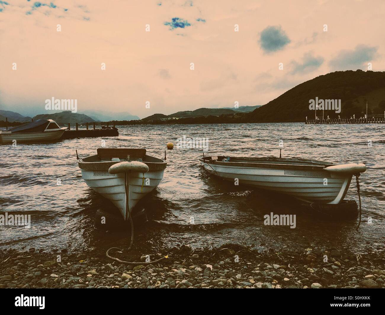 Rowing boats on Ullswater lake - Stock Image