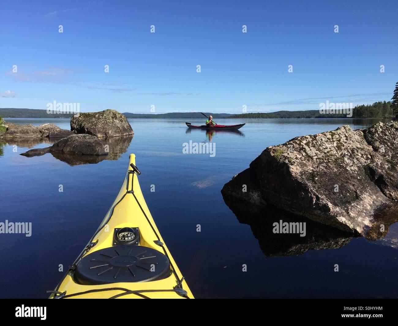 Kayaking on lake Övre Gla, Sweden. - Stock Image