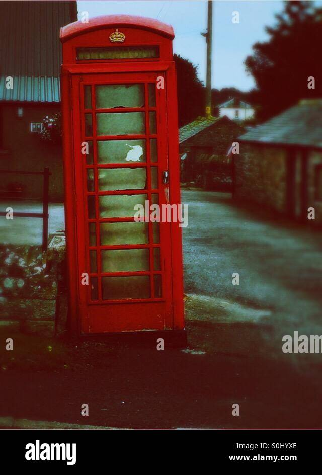 Leaning red telephone box - Stock Image