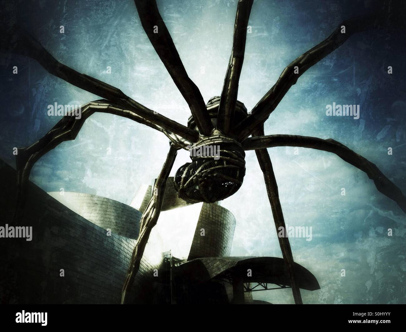 Detail of Spider sculpture and the Guggenheim Museum in Bilbao, Spain - Stock Image