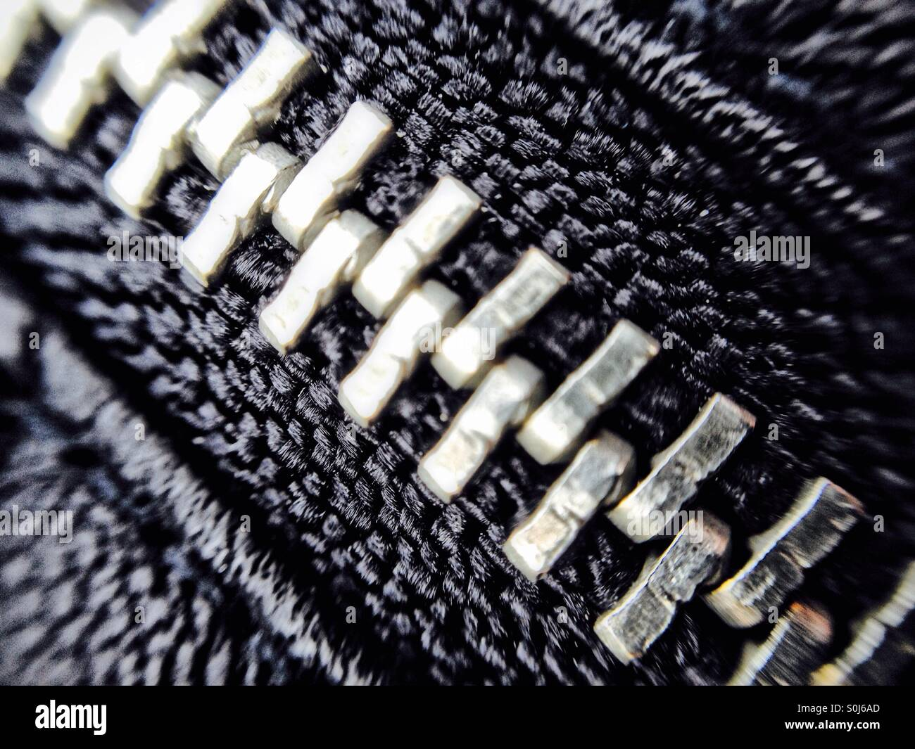 Zip on a leather coat - Stock Image
