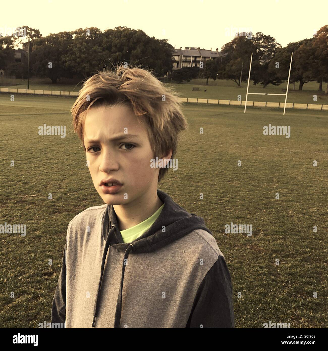 Boy on playing field - Stock Image