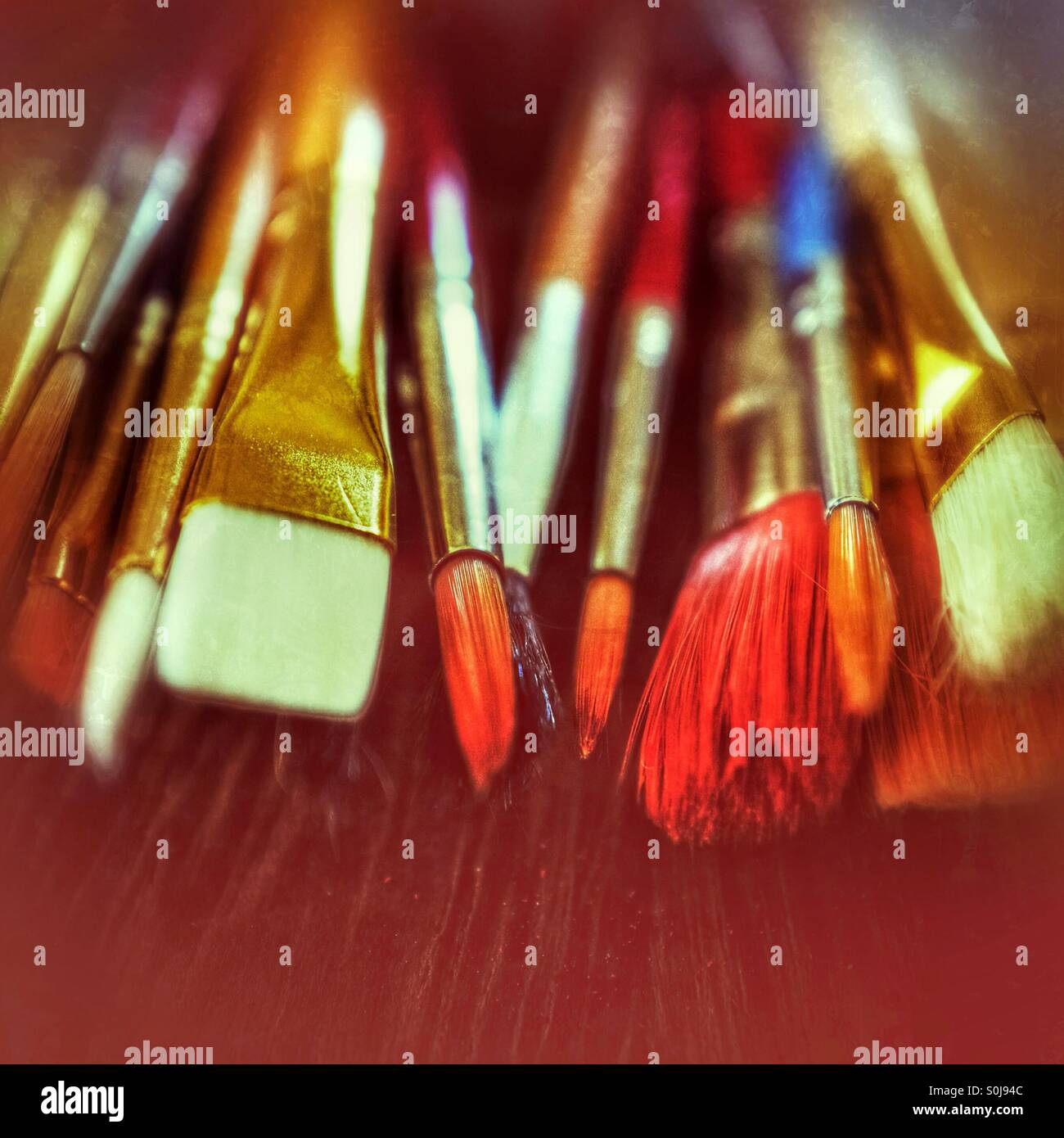 Paint brushes in an artist's studio - Stock Image