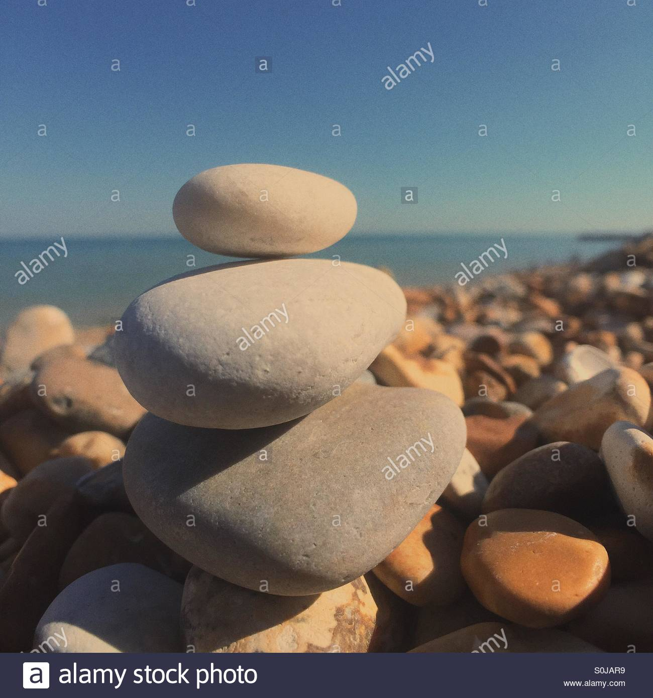 a stack of pebbles on the beach on a hot summer's day, Kingsdown, Deal, Kent - Stock Image