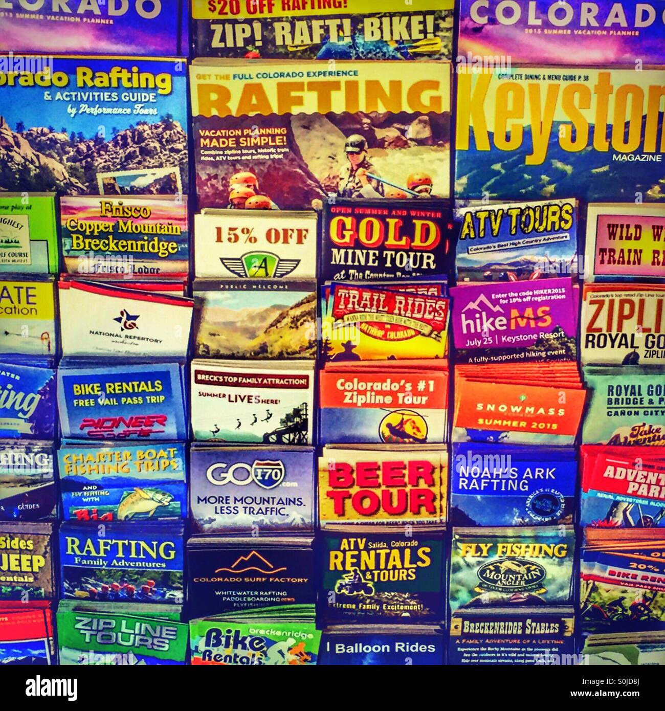 Travel brochures on display - Stock Image