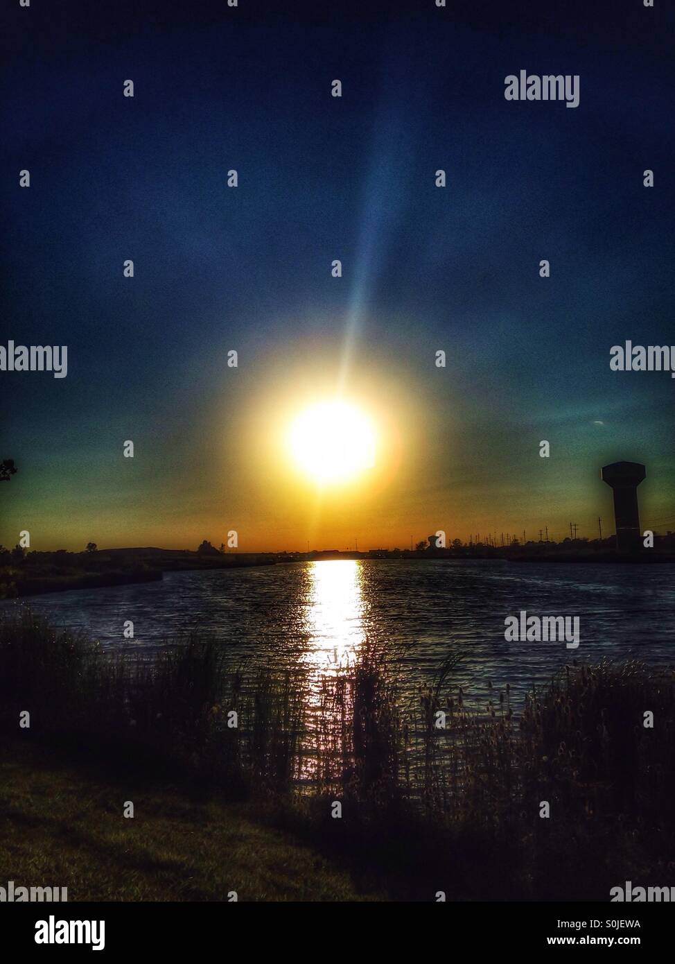 Sunsetting over a lake. - Stock Image