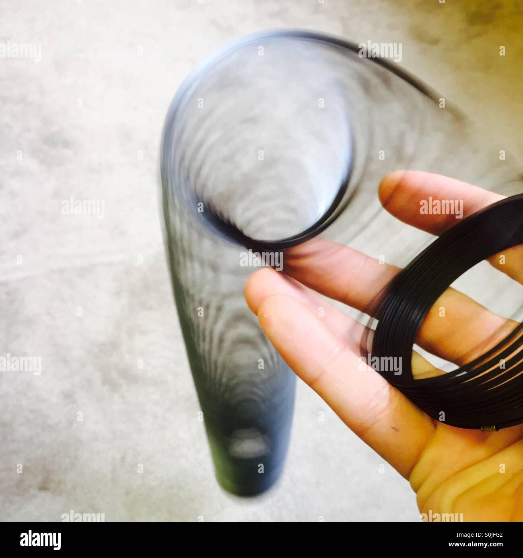 Slinky in hand - Stock Image