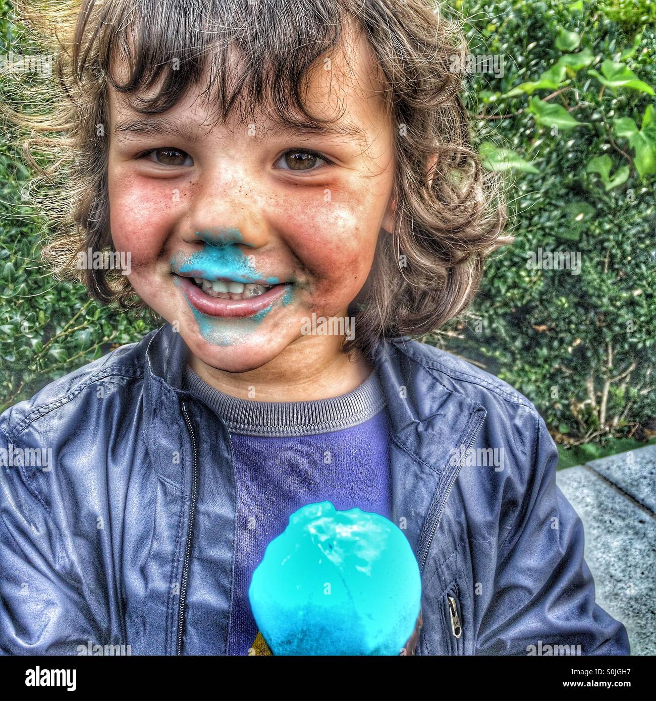4 year old boy with blue ice cream cone - Stock Image