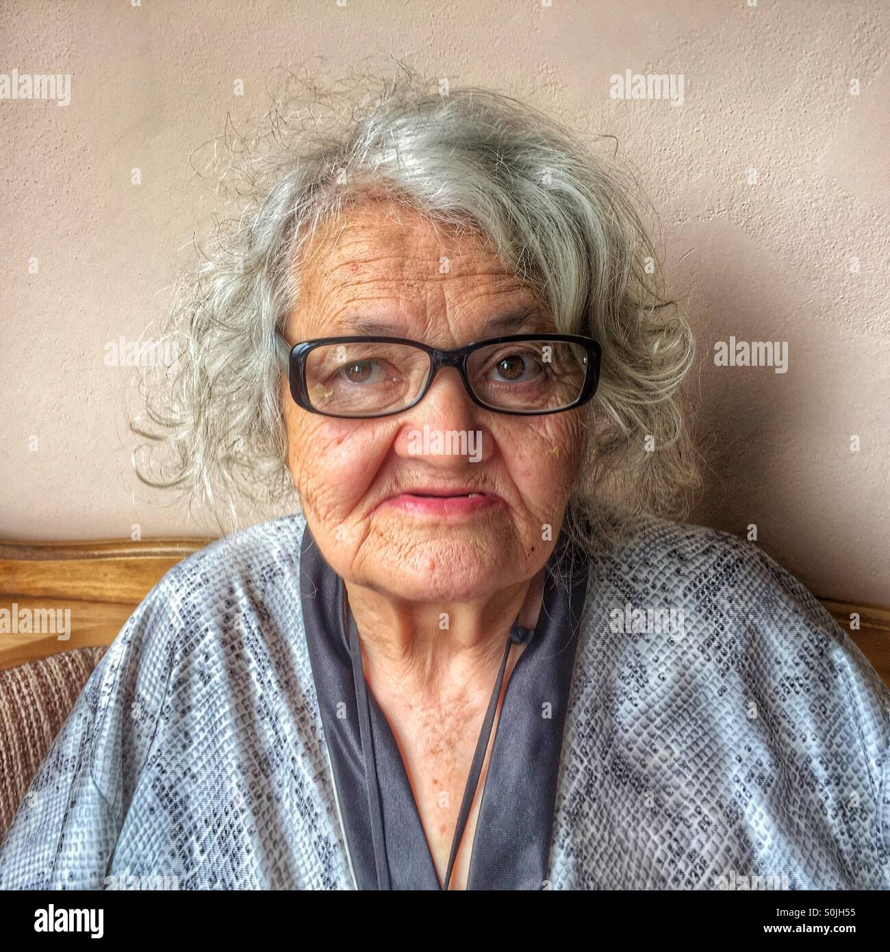 Old woman thinking, portrait - Stock Image
