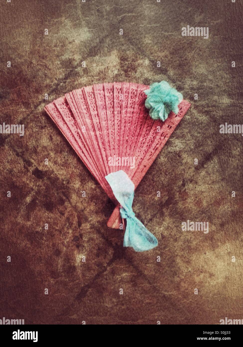 Red fan on the floor. - Stock Image