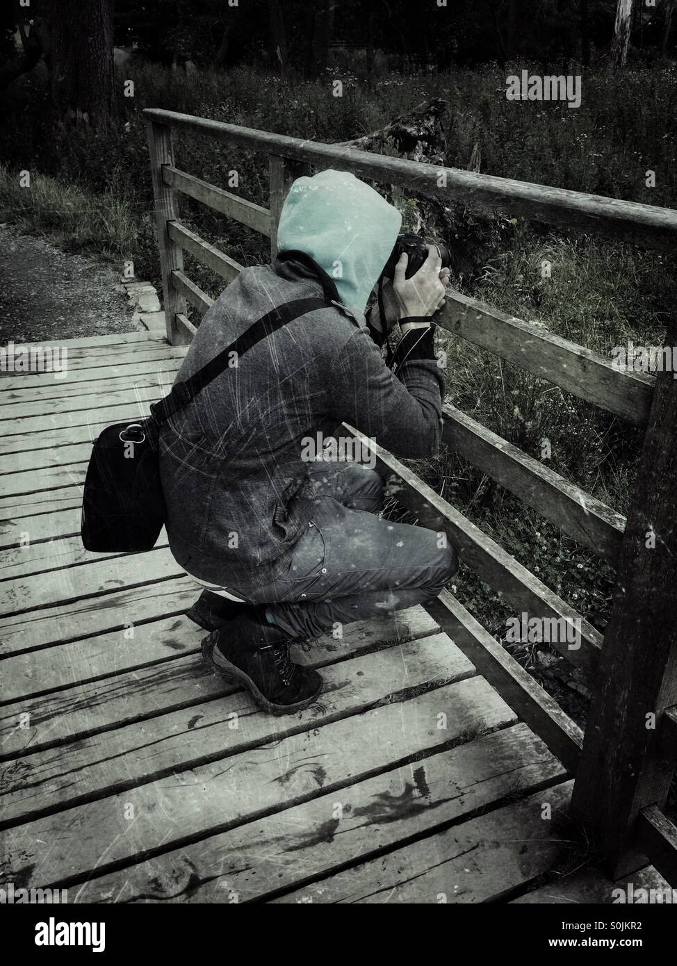 Photographer taking an image - Stock Image
