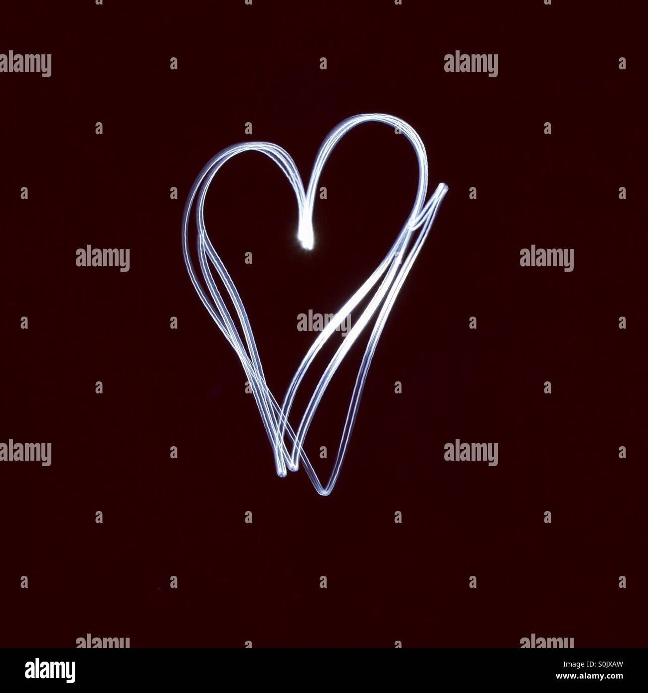 Light painting heart shape - Stock Image