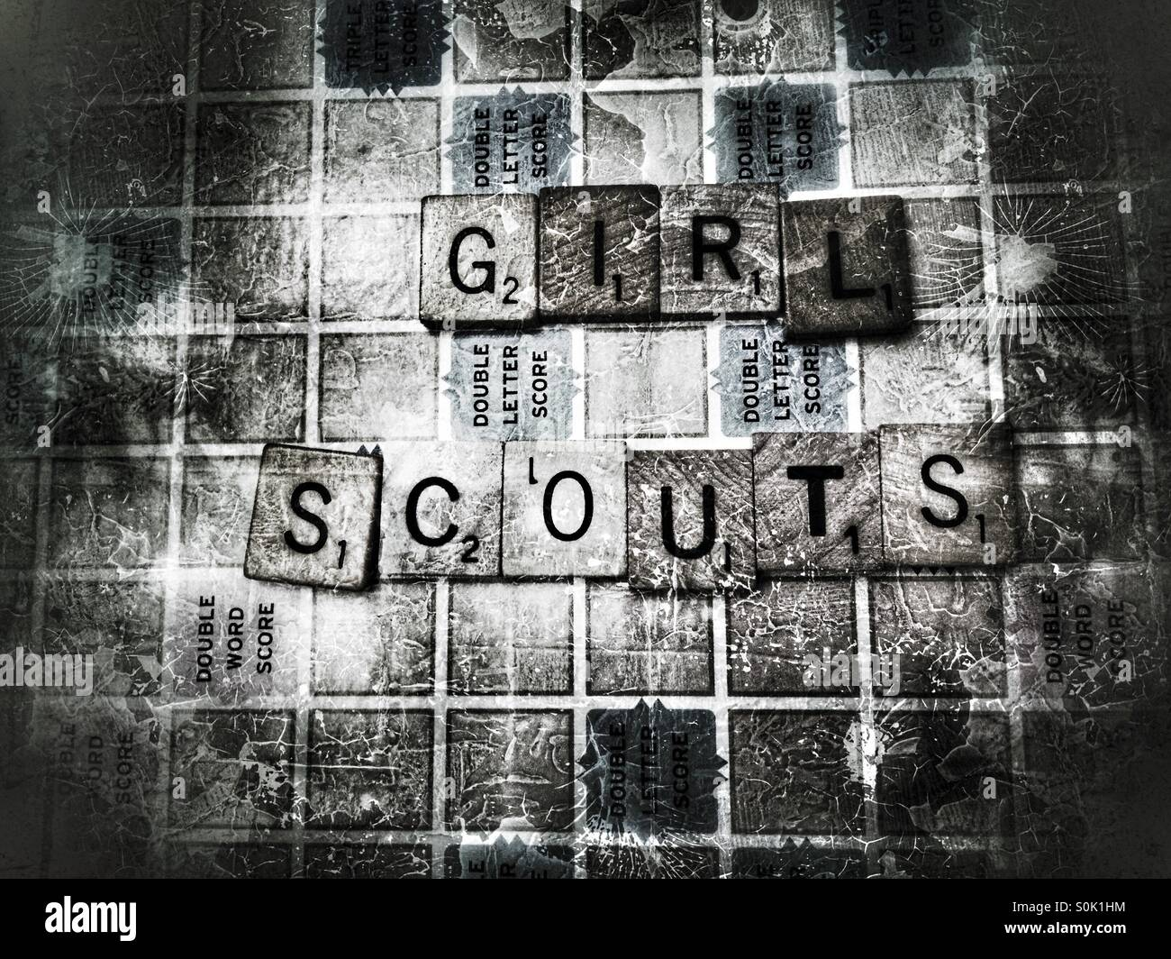 Scrabble game word Girl Scouts - Stock Image