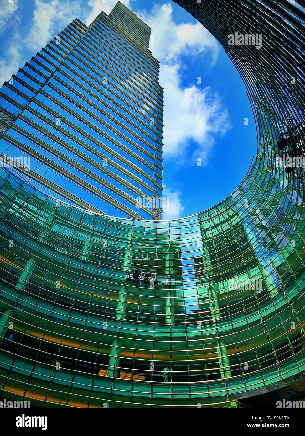 Curved glass atrium at 1 Beacon Court, Bloomberg tower, NYC. - Stock Image