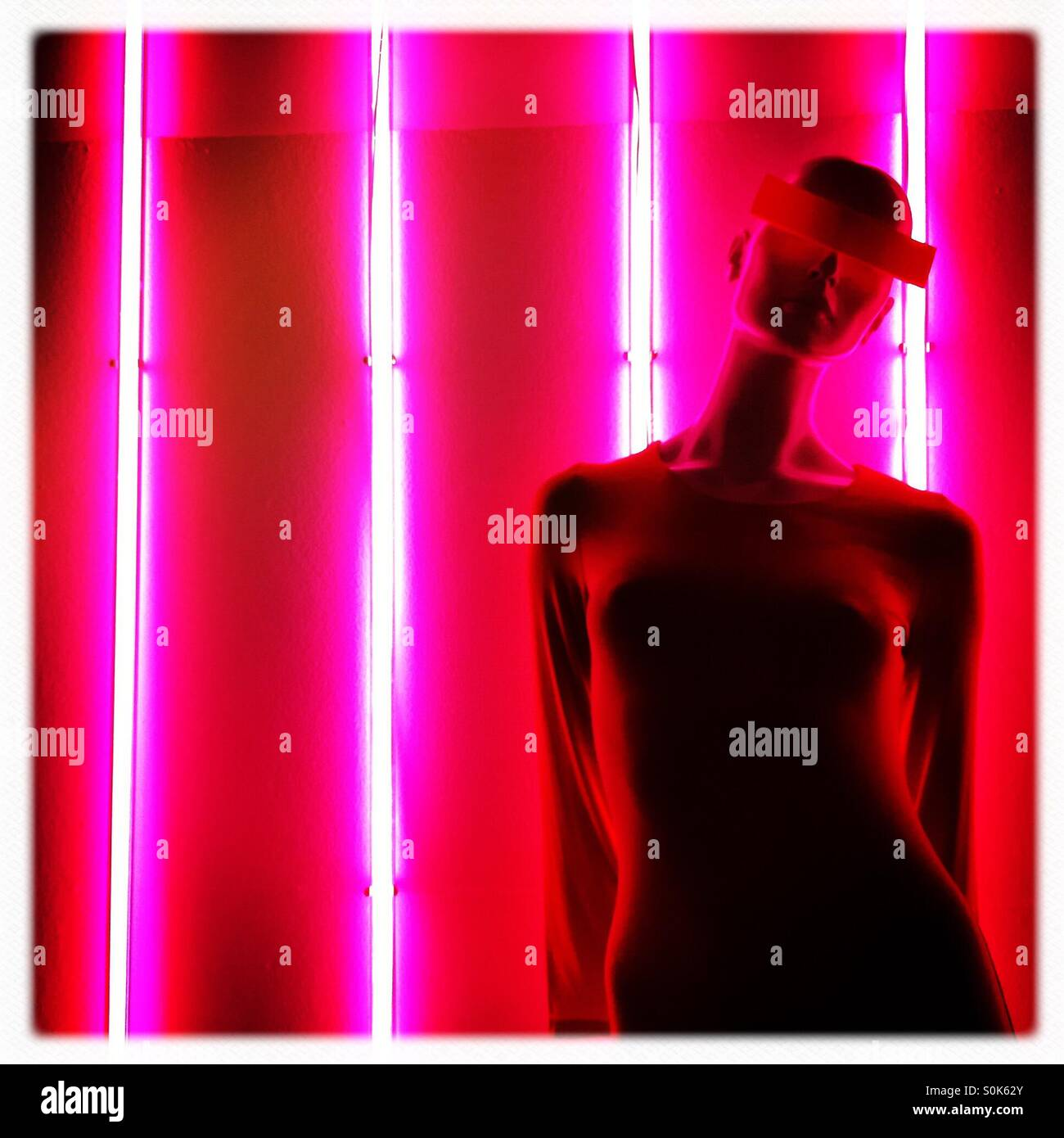 Neon lights and mannequin - Stock Image