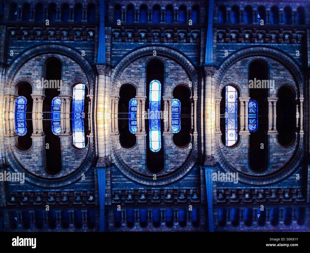 Photo manipulation of arches in the Natural History  Museum - Stock Image