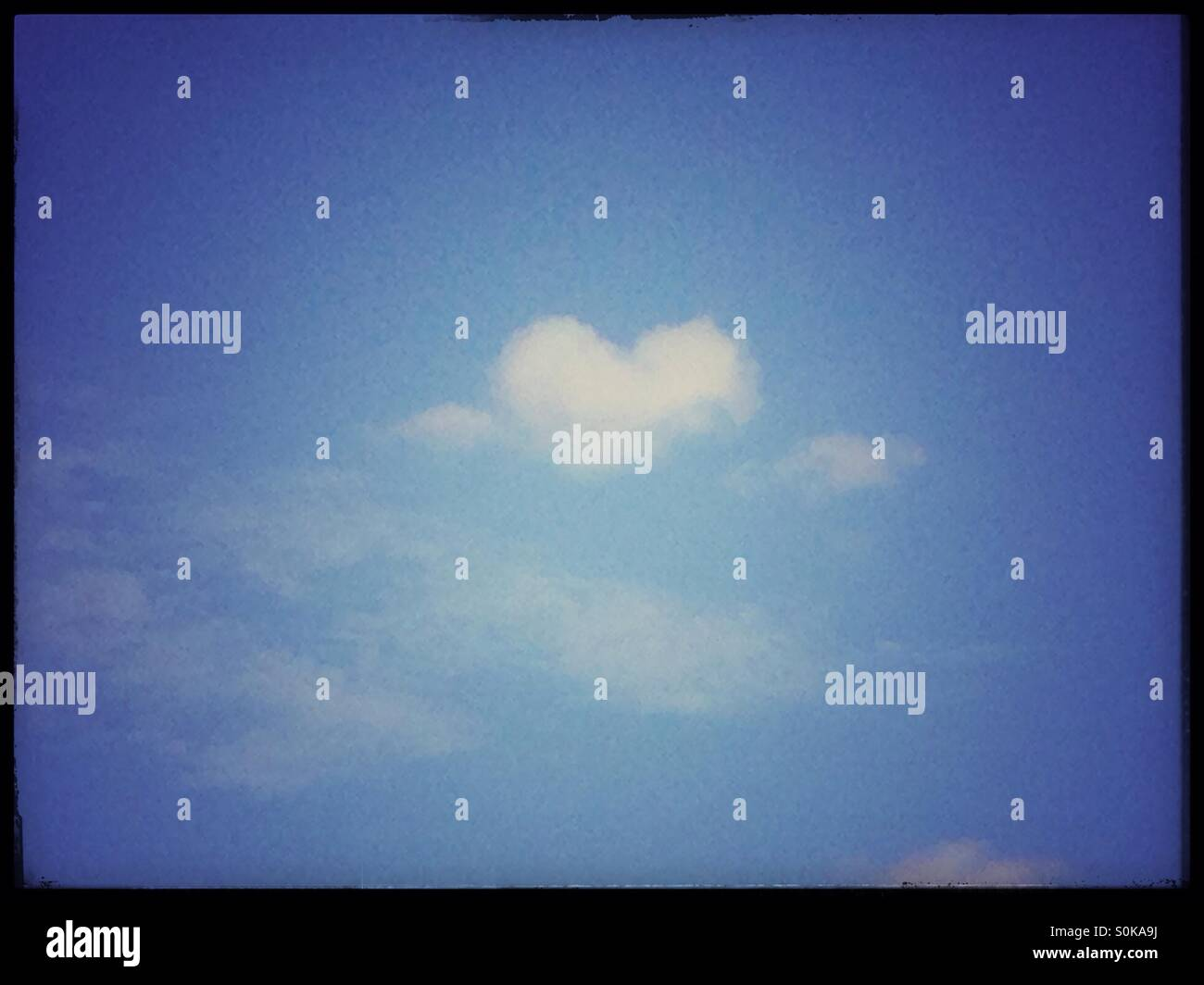 Heart in a cloud. - Stock Image