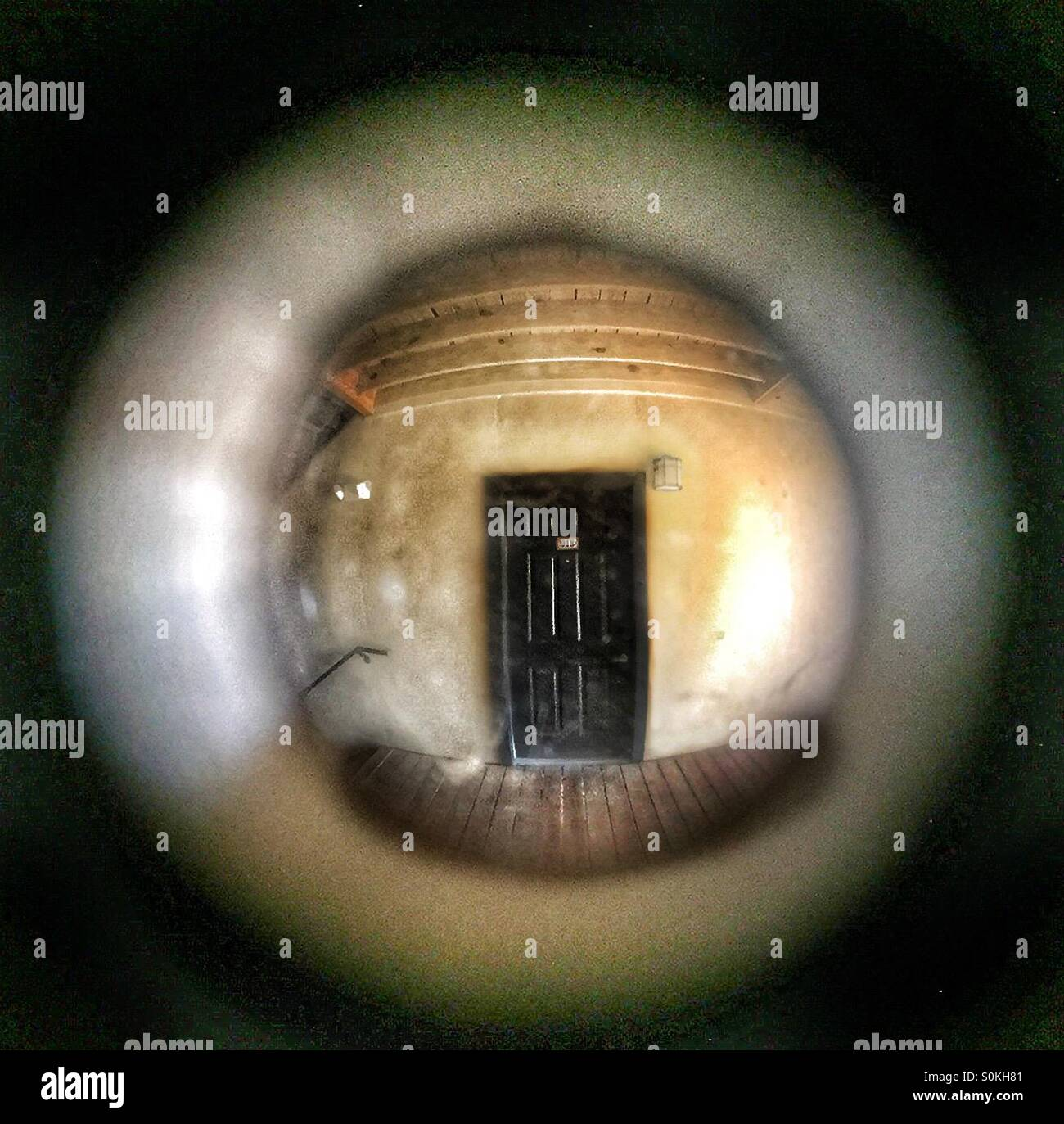 View Of Door Through Peephole   Stock Image