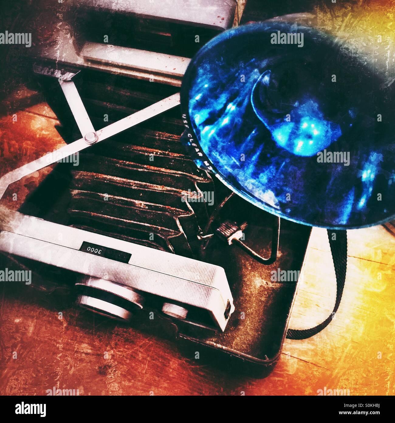 An old camera and blue flashgun - Stock Image