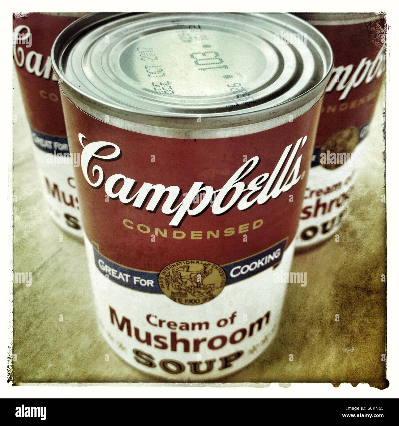 Three tins of Campbell's mushroom soup in a vintage style - Stock Image