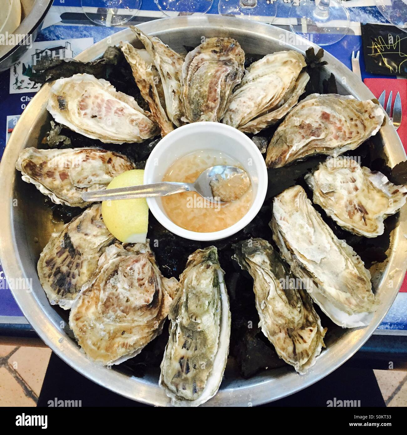 Oysters with lemon and sauce - Stock Image