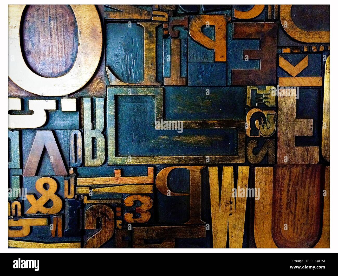 Old print letters on wood - Stock Image