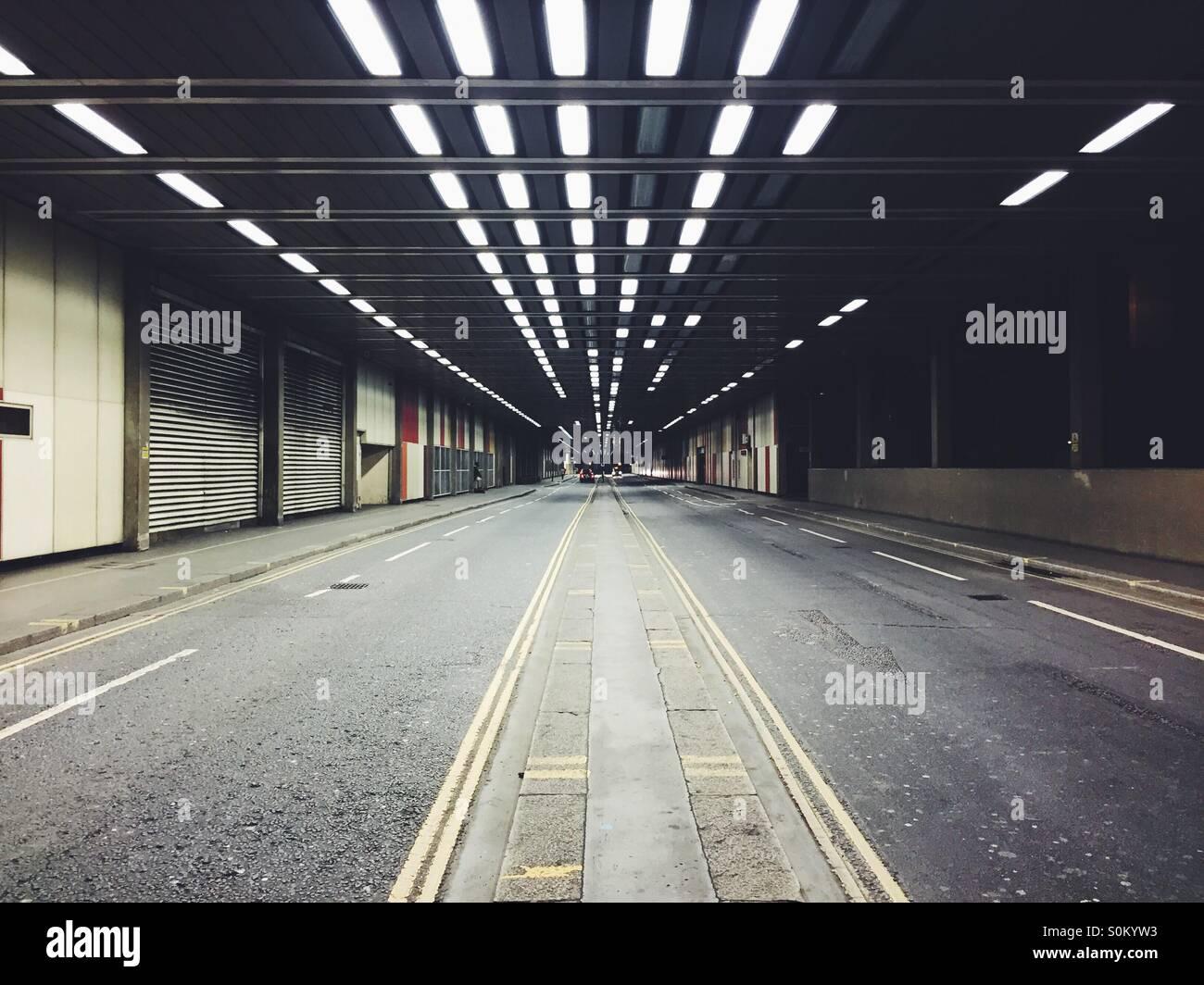 Abstract tunnel lighting, Barbican, London. - Stock Image