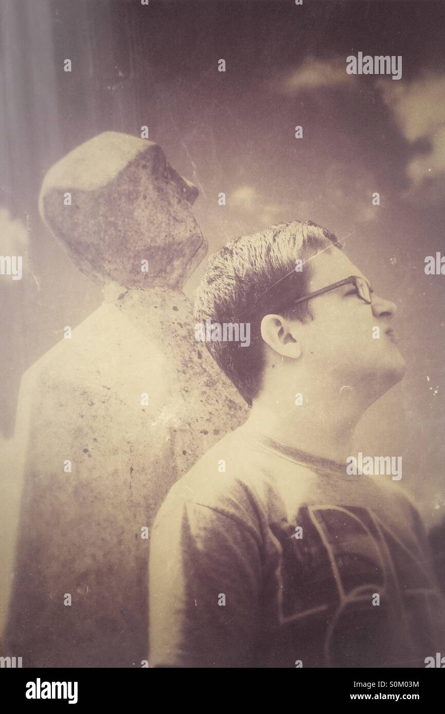 A young man with a stone shadow and a vintage texture. - Stock Image