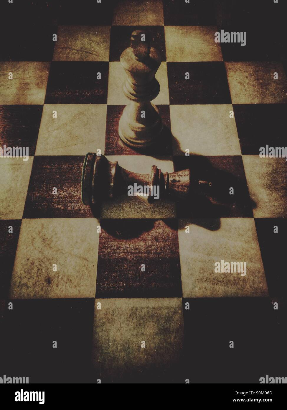 Defeated chess King - Stock Image