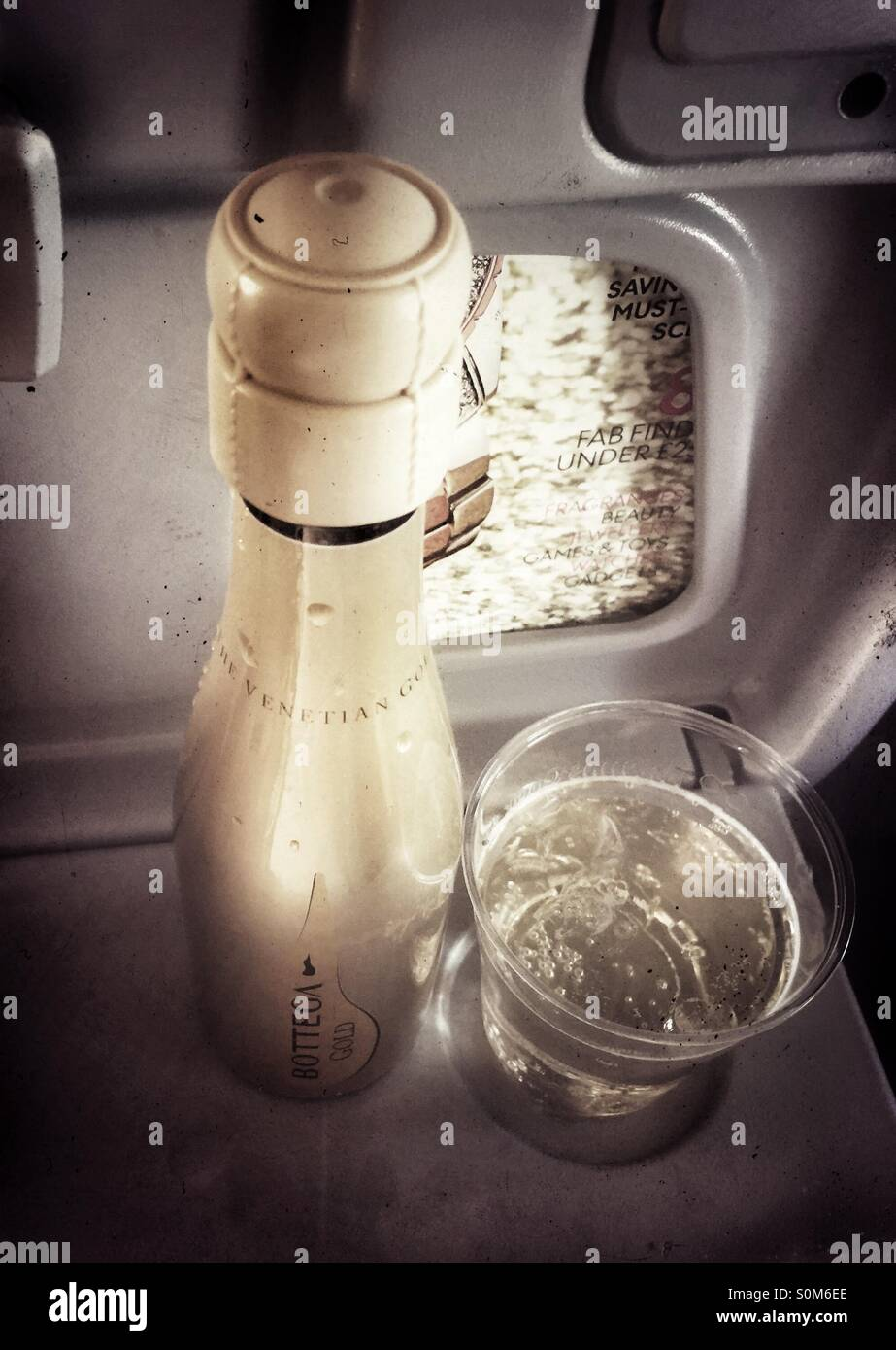 Inflight drink of bubbly - Stock Image