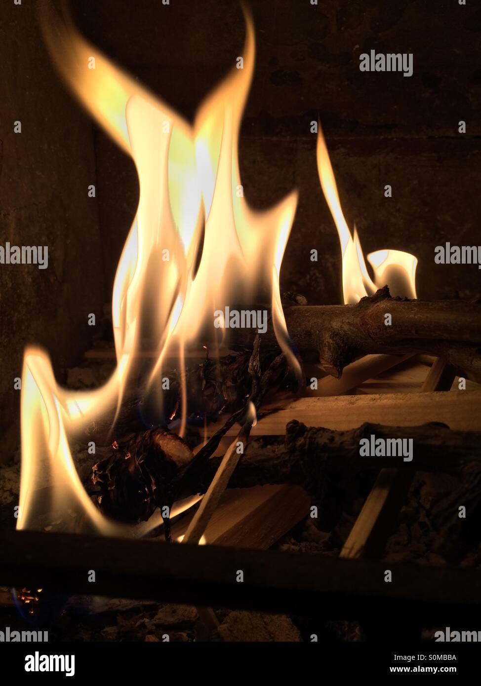 Lit up and throwing out heat. - Stock Image
