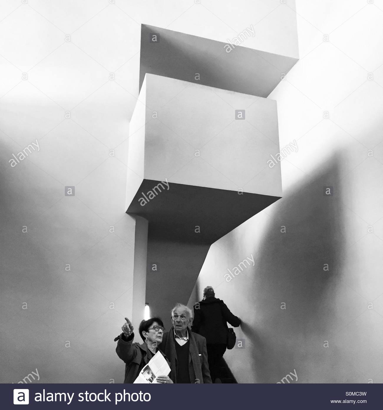 Visitors contemplating the architecture of Le Corbusier in Maison La Roche. - Stock Image