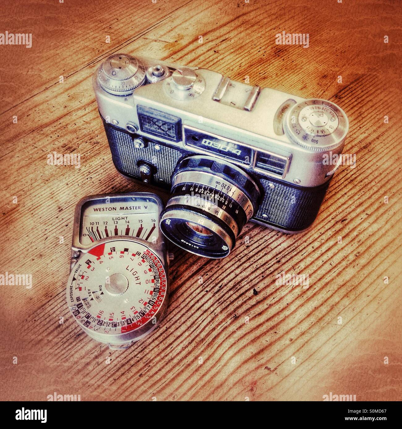 Old Russian FED4 film camera and Weston light meter - Stock Image